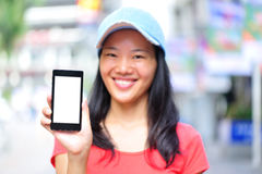 Young asian woman hold smart phone Royalty Free Stock Photography