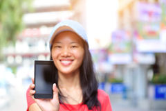Young asian woman hold smart phone. At shopping street Royalty Free Stock Image