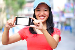Young asian woman hold smart phone Stock Photography