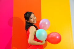 Young Asian Woman Holding Balloons Royalty Free Stock Photography