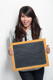 Young asian woman holding blank black board Royalty Free Stock Image