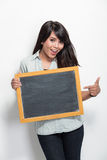 Young asian woman holding blank black board Stock Photos
