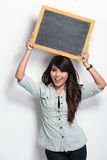 Young asian woman holding blank black board Royalty Free Stock Photos