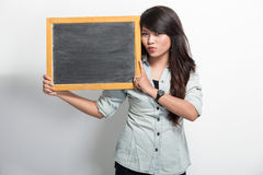 Young asian woman holding blank black board Stock Photo