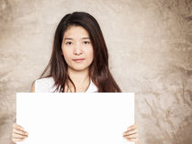 Young asian woman holding blank sign Stock Images