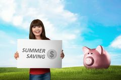 Young asian woman holding board with text Summer saving. Summer saving concept Royalty Free Stock Images