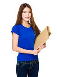 Young Asian woman holding file document Royalty Free Stock Image