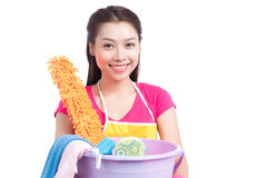 Young asian woman holding floor brush, bucket and rag, isolated Royalty Free Stock Image