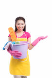 Young asian woman holding floor brush, bucket and rag, isolated Royalty Free Stock Images