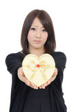 Young asian woman holding a gift box Stock Photos