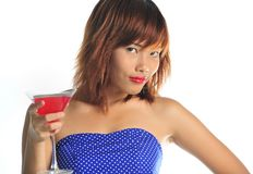 Young asian woman holding a glass of cocktail Stock Photography