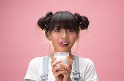 Young asian woman holding a glass of milk Royalty Free Stock Photo