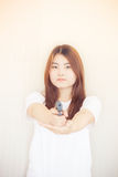 Young asian Woman holding the gun Royalty Free Stock Photo
