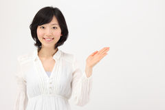 Young Asian woman holding hands Stock Photography
