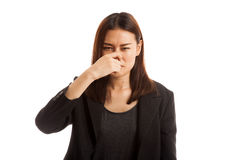 Young Asian woman holding her nose because of a bad smell. Young Asian woman holding her nose because of a bad smell isolated on white background stock image