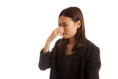 Young Asian woman holding her nose because of a bad smell. Young Asian woman holding her nose because of a bad smell isolated on white background royalty free stock image