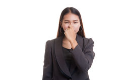 Young Asian woman  holding her nose because of a bad smell. Royalty Free Stock Photography