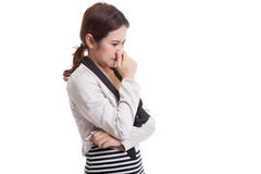 Young Asian woman  holding her nose because of a bad smell. Stock Image