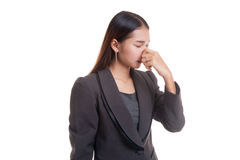 Young Asian woman  holding her nose because of a bad smell. Royalty Free Stock Photo