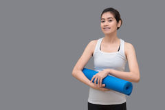 Young asian woman holding her yoga mat at healthy sport gym. Yog. A and meditation have good benefits for health. Photo concept for Yoga Sport and Healthy Royalty Free Stock Photos