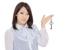 Young asian woman holding a key Stock Photography