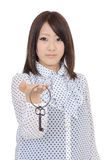 Young asian woman holding key Stock Photography