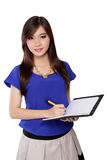 Young Asian woman holding pen and notebook Royalty Free Stock Images