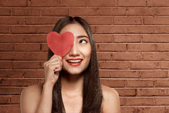 Young asian woman holding red heart Royalty Free Stock Images