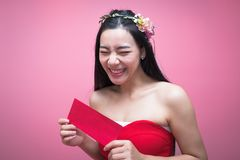 Young asian woman holding Red Packet Stock Photos