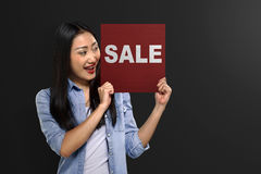 Young asian woman holding signboard with Black Friday message Royalty Free Stock Image