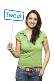 Young asian woman holding a social media sign smiling. On white background Royalty Free Stock Photography