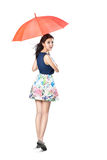 Young asian woman holding a umbrella Stock Photo