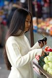 Young asian woman holding vegetables at market Royalty Free Stock Photo