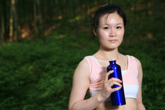 Young asian woman holding water Stock Image