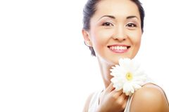 Young asian woman holding white gerber flower Royalty Free Stock Photography