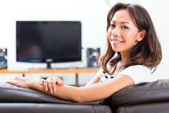 Young asian woman at home on the sofa Stock Image