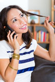 Young Asian woman at home on the sofa Royalty Free Stock Photography