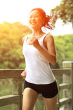 Young asian woman jogging at park Stock Photo