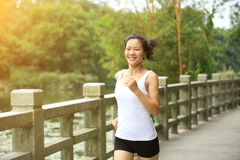 Young asian woman jogging at park Royalty Free Stock Photos