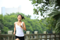 Young asian woman jogging at park Royalty Free Stock Image