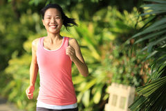 Young asian woman jogging at park Stock Photography