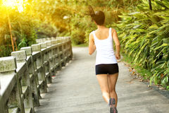 Young asian woman jogging at park Royalty Free Stock Photography