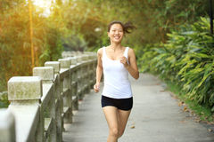 Young asian woman jogging at park Stock Photos