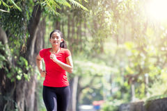 Young asian woman jogging at the park Stock Photo
