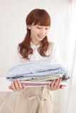 Young Asian woman with laundry Royalty Free Stock Photo