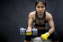 Young Asian woman lifting dumbbell, weight training Stock Images