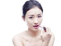 Young asian woman with lipstick Royalty Free Stock Photography