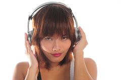 Young asian woman listening music Royalty Free Stock Photography