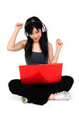 Young Asian Woman Listening Music From The Compute Royalty Free Stock Images