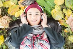 Young asian woman listening music Stock Photography
